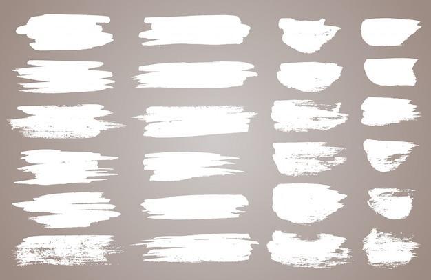 Conjunto de manchas de tinta branca.
