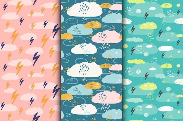 Conjunto de mão abstrata sem costura desenhada padrões hipster com nuvens, gotas de chuva, relâmpagos, céu. ilustração.