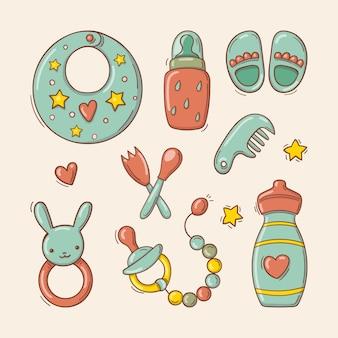 Conjunto de mão desenhada de brinquedos e acessórios para bebê. Vetor Premium