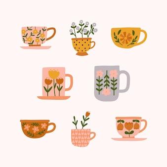 Conjunto de mão desenhada de várias xícaras de chá florais na moda modernos ou canecas com diferentes enfeites de flores fofas em estilo escandinavo.