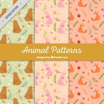 Conjunto de mão desenhada padrões animais adoráveis