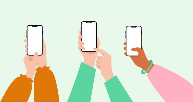 Conjunto de mãos de mulher usando smartphone com tela em branco.