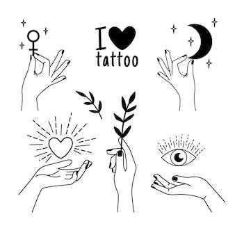 Conjunto de mãos femininas de tatuagem.