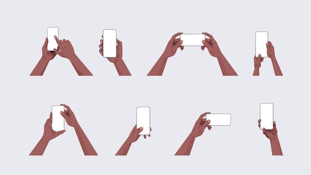 Conjunto de mãos humanas segurando smartphones com telas de toque em branco usando telefones celulares