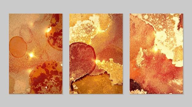 Conjunto de mármore de fundos abstratos laranja, vermelho e dourado com glitter na técnica de tinta a álcool