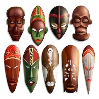 Conjunto de máscaras esculpidas africanas realistas em madeira com ornamentos coloridos.