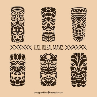 Conjunto de máscaras tribais desenhadas a mão
