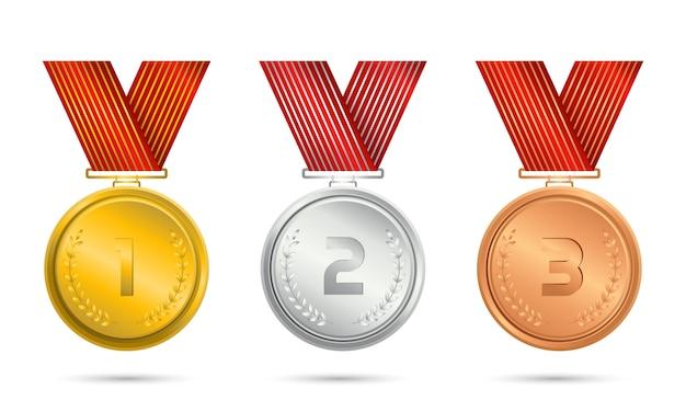 Conjunto de medalha de ouro, prata e bronze com fita.