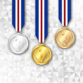 Conjunto de medalhas de ouro prata e bronze.