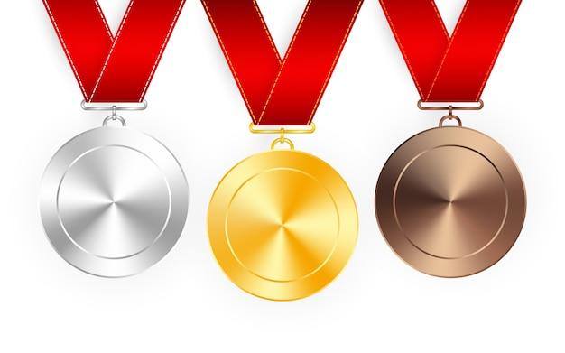 Conjunto de medalhas de prêmio de ouro, prata e bronze com fitas vermelhas. medalha redonda coleção vazia do vetor polido isolada no fundo branco. emblemas premium.
