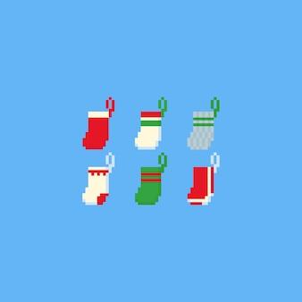 Conjunto de meia de natal de pixel.