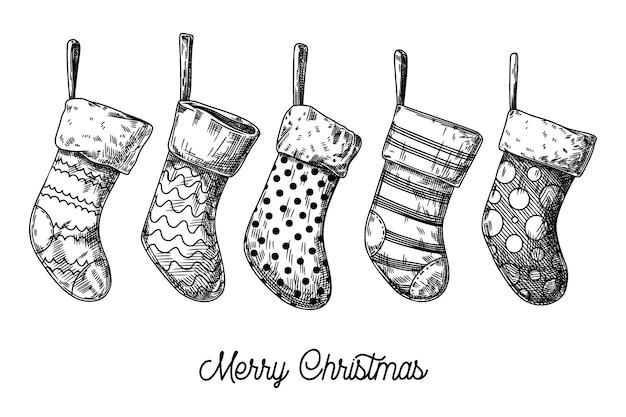 Conjunto de meias de natal. meias diferentes isoladas no fundo branco. esboço, vetor