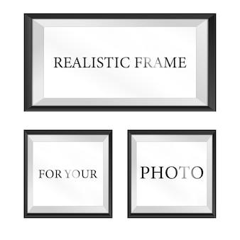 Conjunto de modelo de moldura de foto preto isolado na parede branca.