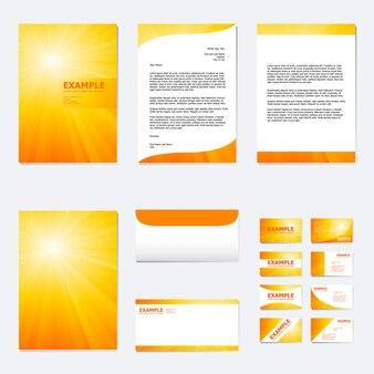 Conjunto de modelo de papel de negócios com raio de luz do sol na laranja