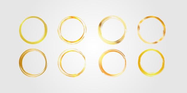 Conjunto de moldura de círculo de ouro, círculo dourado desenhado à mão, ornamento de escova.