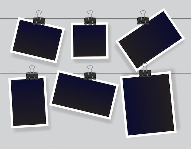 Conjunto de molduras para fotos instantâneas em branco pendurado em um clipe. modelos de photoframe vintage vazio preto. ilustração isolada em fundo cinza.