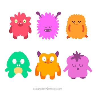 Conjunto de monstros engraçados em estilo desenhado à mão