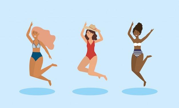 Conjunto de mulheres pulando e vestindo maiô com chapéu