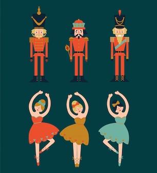 Conjunto de natal com quebra-nozes e bailarinas em fundo azul.