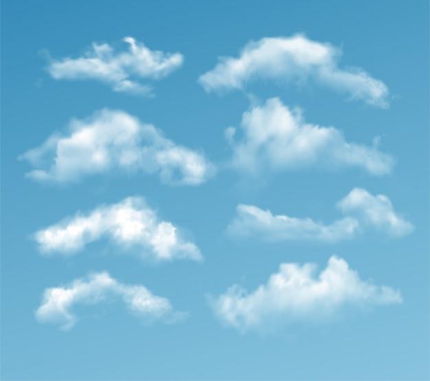 Conjunto de nuvens diferentes transparentes isoladas em azul