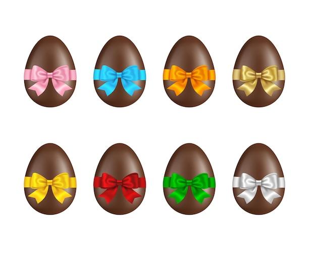 Conjunto de ovos de páscoa de chocolate com laços coloridos e ilustração de fitas