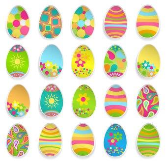 Conjunto de ovos de páscoa de papel com vários enfeites e sombras Vetor Premium
