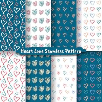 Conjunto de padrão sem emenda de doodle desenhado de mão de coração, amor, padrão de corações sem emenda