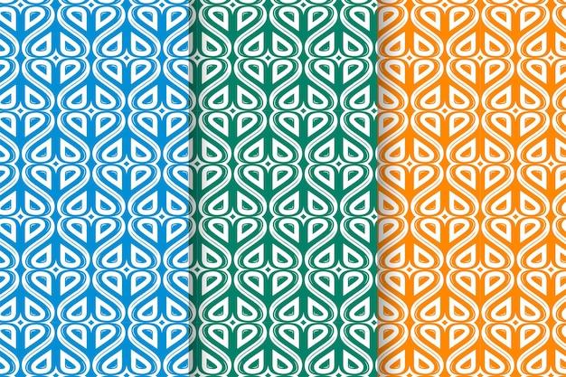 Conjunto de padrões abstratos sem costura desenhados à mão com corações em fundo vibrante. três cores selecionadas são azul, verde e laranja. pode ser usado para brochura de banner de publicidade e cartões de dia dos namorados