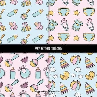 Conjunto de padrões de bebê em estilo desenhado a mão