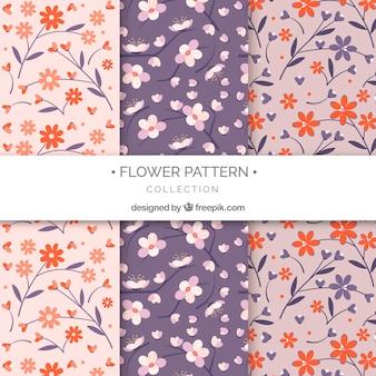 Conjunto de padrões de flores coloridas em estilo plano