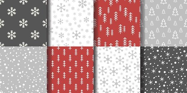 Conjunto de padrões de inverno sem costura com flocos de neve e árvores spruce.