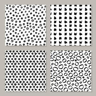 Conjunto de padrões preto e brancos sem costura desenhados à mão.