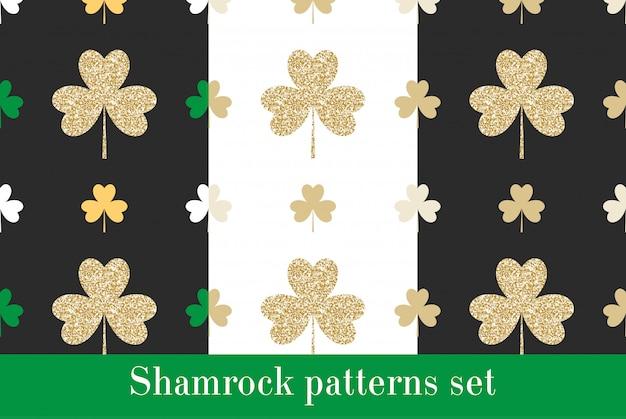 Conjunto de padrões sem emenda com trevos de ouro reluzente.