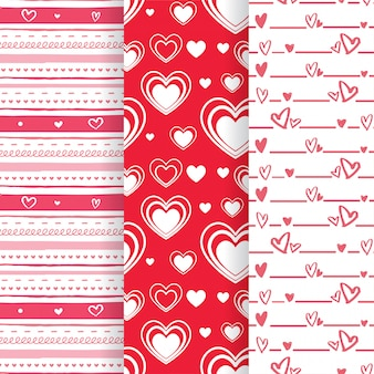 Conjunto de padrões sem emenda de forma adorável coração rosa e vermelho