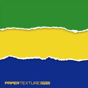 Conjunto de papéis brilhantes lacerados nas cores da bandeira do brasil,