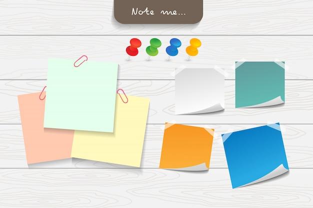 Conjunto de papéis de nota de cor diferente e elementos de fita.