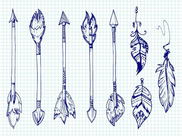 Conjunto de penas e flechas de caneta esferográfica na página do caderno