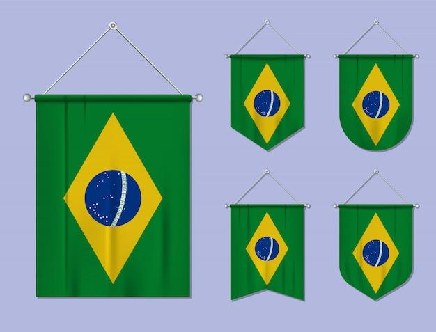 Conjunto de pendurar bandeiras brasil com textura têxtil. formas de diversidade do país de bandeira nacional. galhardete de modelo vertical