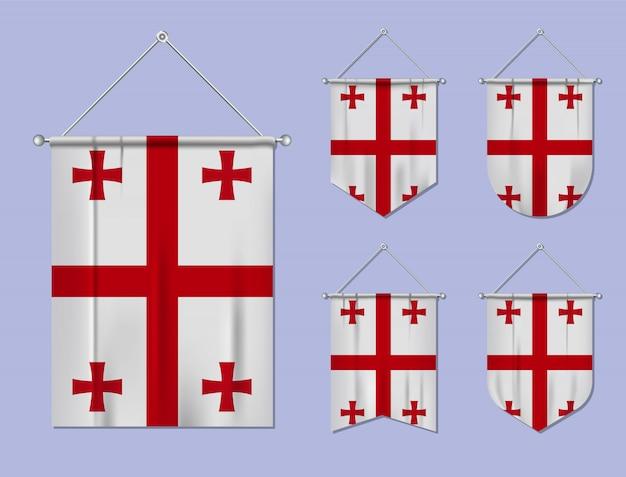 Conjunto de pendurar bandeiras da geórgia com textura de têxteis. formas de diversidade do país de bandeira nacional. galhardete de modelo vertical
