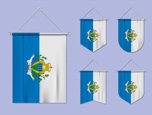 Conjunto de pendurar bandeiras san marino com textura de têxteis. formas de diversidade do país de bandeira nacional. galhardete de modelo vertical.