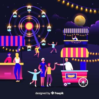Conjunto de pessoas em uma feira de noite