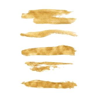 Conjunto de pinceladas douradas feitas à mão