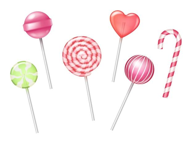 Conjunto de pirulitos coloridos festivos e bastões de doces