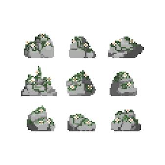 Conjunto de pixel art de pedra com ilustração de planta.