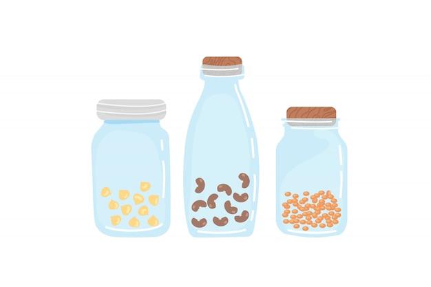 Conjunto de potes de vidro com lentilhas, grão de bico, feijão