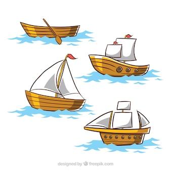 Conjunto de quatro barcos de madeira