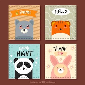 Conjunto de quatro cartões de animais em design plano