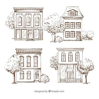 Conjunto de quatro casas desenhadas a mão