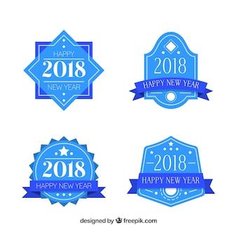 Conjunto de quatro emblemas do ano novo azul