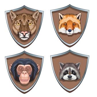 Conjunto de quatro personagens de cabeças de animais em ilustração de escudos